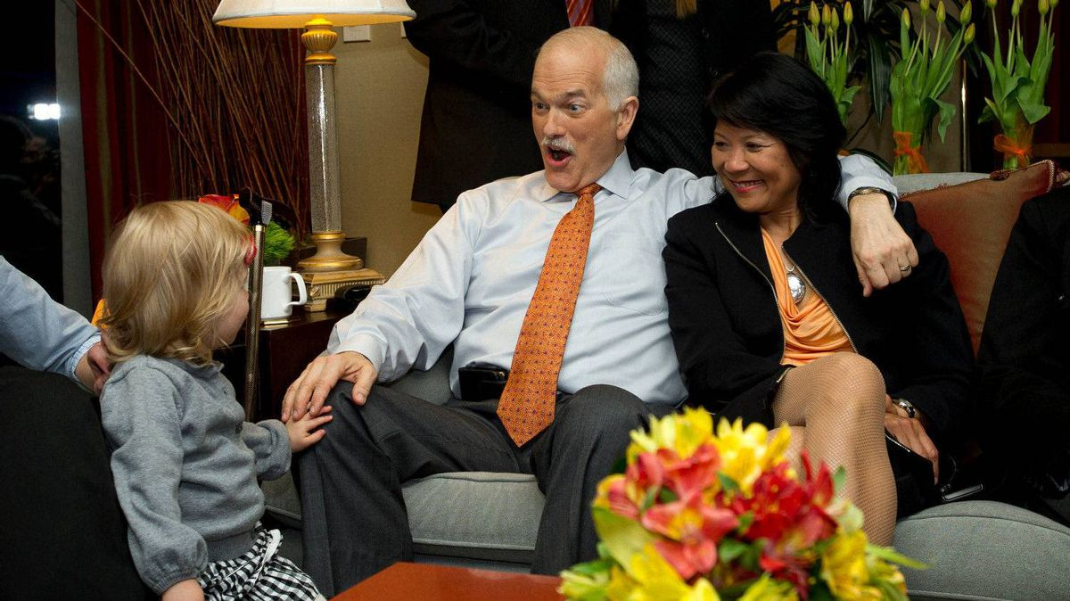 New Democratic Party Lleader Jack Layton and Olivia Chow react to grand-daughter Beatrice while watching election results come in from a hotel suite in Toronto, Ont. May 2/2011.