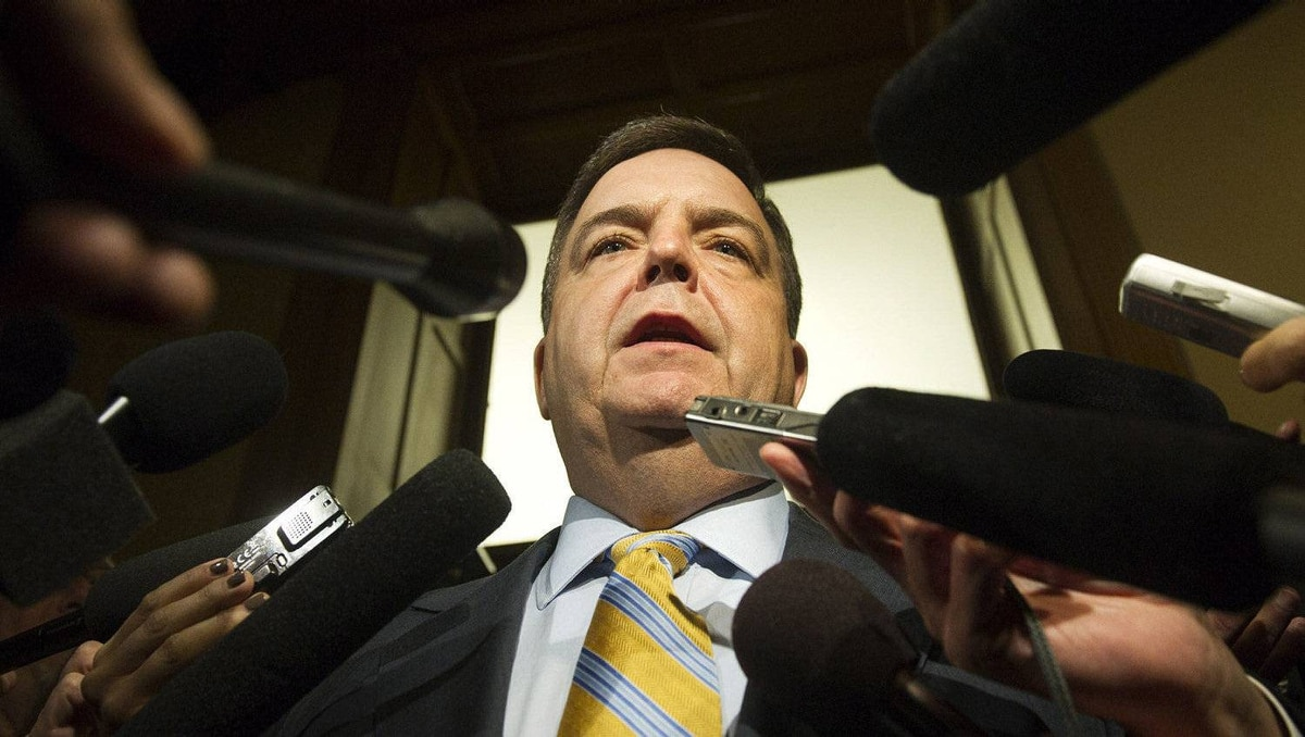 Ontario Finance Minister Dwight Duncan is scrummed by the media after the 2012 provincial budget vote at Queen's Park in Toronto on Tuesday, April 24, 2012.