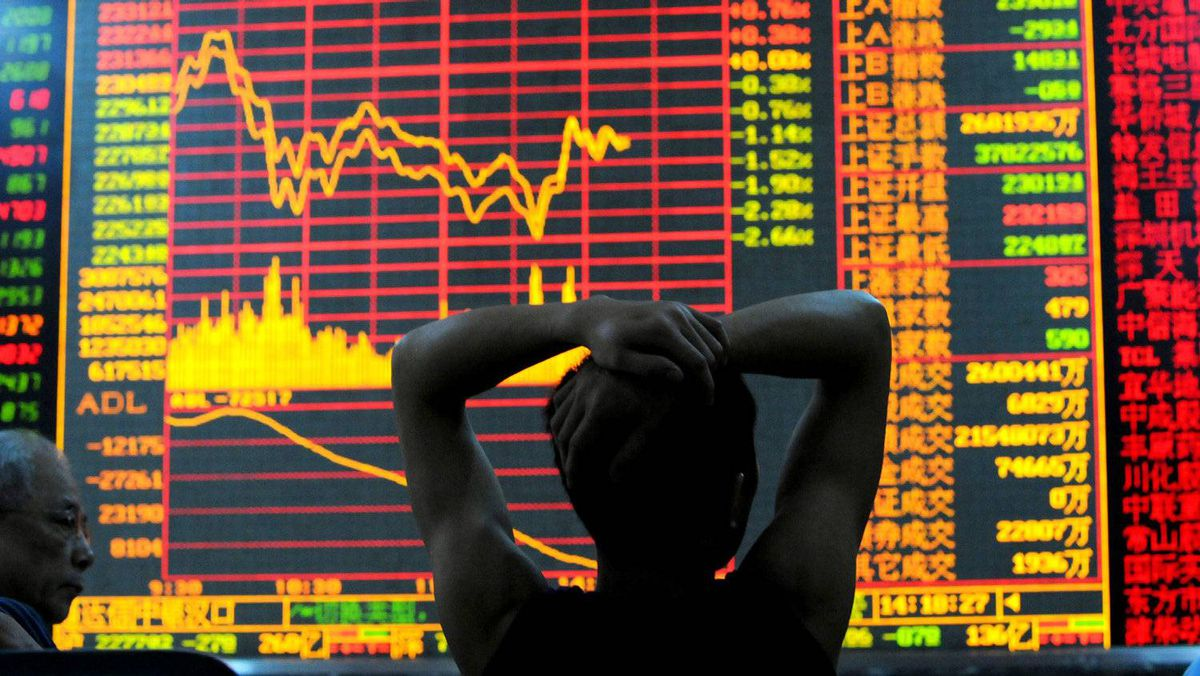 An investor views stock indexes at a securities company in Wuhan of Hubei Province, China.