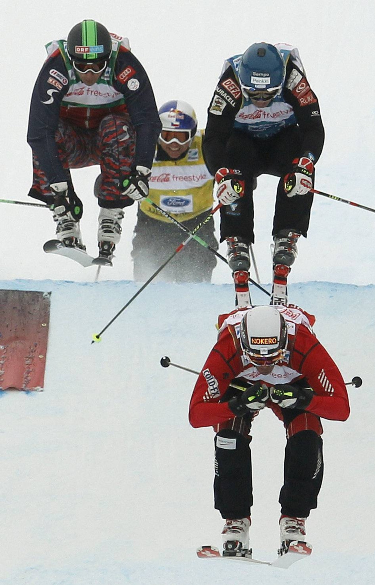 Chris Del Bosco of Canada races to a first place finish in front of second-placed Jouni Pellinen, right, of Finland, third-placed Andreas Matt of Austria, left, and fourth-placed Tomas Kraus of the Czech Republic during the men's ski cross finals at the FIS Freestyle World Championships in Park City, Utah February 4, 2011.