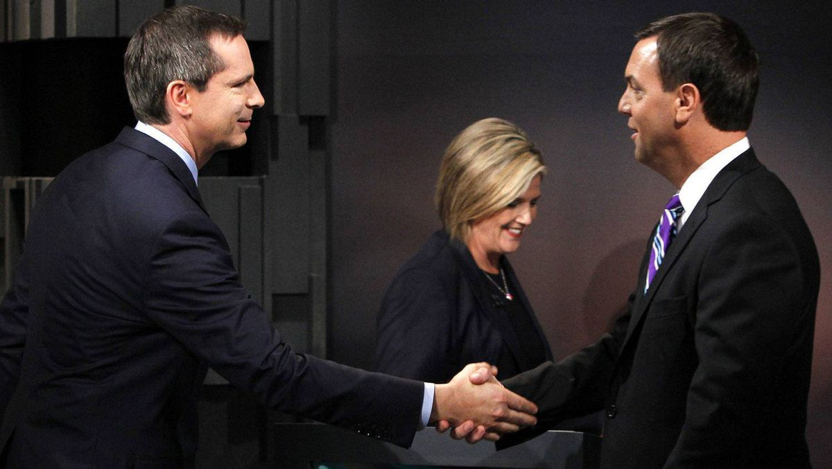 Ontario Premier and Liberal leader Dalton McGuinty (L) shakes hands with provincial Conservative leader Tim Hudak as provincial NDP leader Andrea Horvath (C) walks past after the provincial Ontario leaders debate in Toronto September 27, 2011.