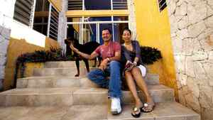 Joel Khawly and wife Sheila Khawly outside the home they built in Jacmel.