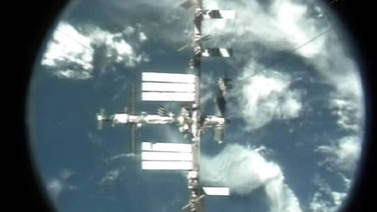 The International Space Station is seen through the docking port of the U.S. space shuttle Atlantis as it departs the station in this still image taken from NASA TV on July 19, 2011.