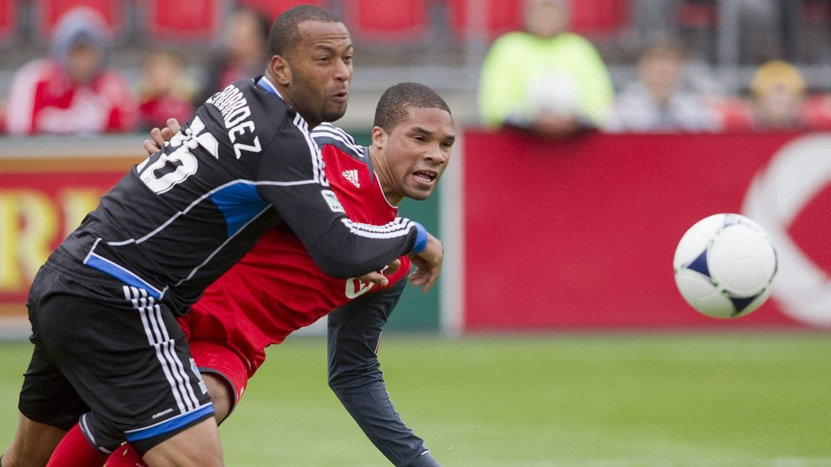 Toronto FC 's Ryan Johnson (right) battles for the ball with South Jose Earthquakes' Victor Bernardez during first half MLS action in Toronto on Saturday, March 24, 2012.