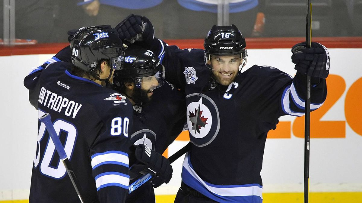 Winnipeg Jets' Andrew Ladd (R) celebrates his goal against the Tampa Bay Lightning with Nik Antropov (L) and Johnny Oduya during the second period of their NHL game in Winnipeg, November 14, 2011.