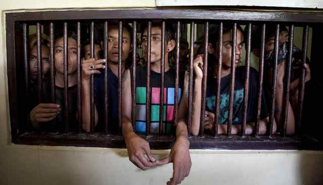 "A group of arrested Indonesian punks are jailed in Bandah Aceh police station in Aceh province. Sharia police are ""morally rehabilitating"" more than 60 young punk rock fans, saying the youths tarnish the province's staunch Islamic image."