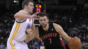 Andrea Bargnani #7 of the Toronto Raptors drives on David Lee #10 of the Golden State Warriors at Oracle Arena on March 25, 2011 in Oakland, California. NOTE TO USER: User expressly acknowledges and agrees that, by downloading and or using this photograph, User is consenting to the terms and conditions of the Getty Images License Agreement. (Photo by Ezra Shaw/Getty Images)