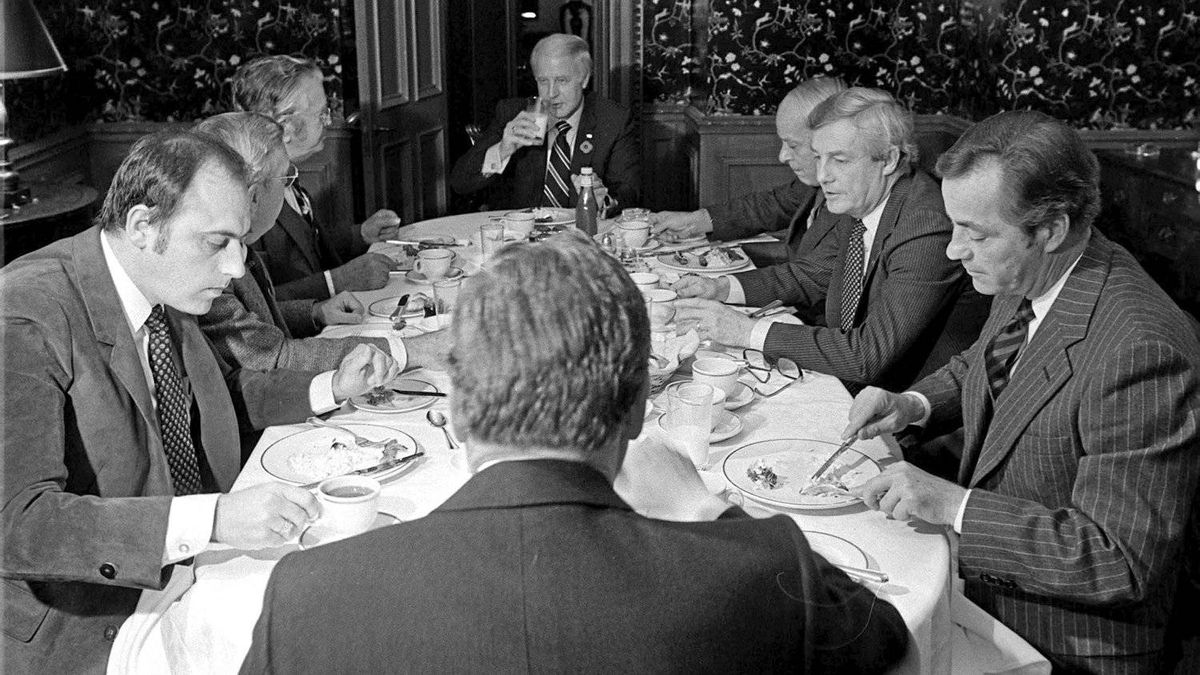 The eight dissenting premiers who disagree with Prime Minister Trudeau's constitutional package sit for breakfast in Ottawa, Nov. 3, 1981. Clockwise from left: Brian Peckford, Newfoundland; Allan Blakney, Saskatchewan; Angus MacLean, P.E.I.; John Buchanan, Nova Scotia; Rene Levesque, Quebec; Peter Lougheed, Alberta; William Bennett, British Columbia; and Sterling Lyon of Manitoba(back to camera).