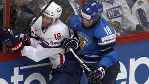 France's Yohann Auvitu (R) chases Finland's Jesse Joensuu during their 2012 IIHF men's ice hockey World Championship game in Helsinki May 10, 2012.