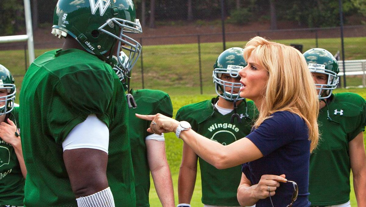 "QUINTON AARON as Michael Oher and SANDRA BULLOCK as Leigh Anne Tuohy in Alcon Entertainment's drama ""The Blind Side,"" a Warner Bros. Pictures release."